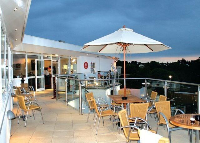 Bar/restaurant outdoor terrace overlooking pool