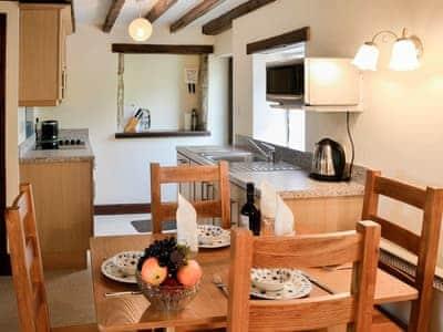 Dining area and adjacent kitchen | Swaledale Cottage - Swaledale and Ellerbeck Cottages, Caldbeck, near Keswick