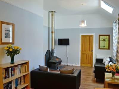 Tastefully furnished living area | Clocktower Cottage, Kildonan, near Girvan