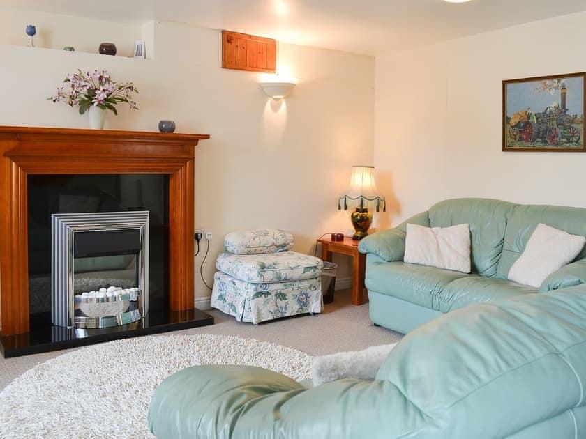 Cosy and comfortable living room | Deuglawdd Cottage - Deuglawdd Farm, Aberdaron, near Pwllheli
