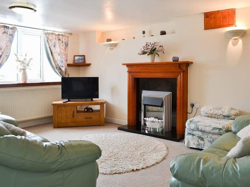 Warm and welcoming living room | Deuglawdd Cottage - Deuglawdd Farm, Aberdaron, near Pwllheli