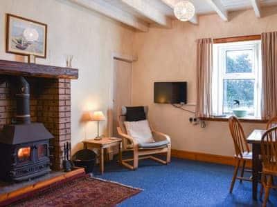 Living room/dining room   Burnside Cottage, Sliddery, Isle of Arran