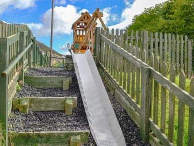 Children's play area | Grajo Cottage, Derwent Dale Cottage , Brackendale - Doddick Farm Cottages, Threlkeld, near Keswick