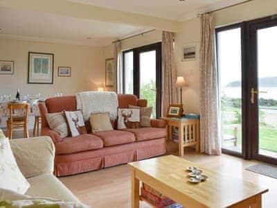 Convenient open-plan living space | Rivendell, Lamlash, Isle of Arran