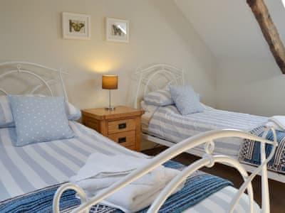 Twin bedroom | Swallow Barn, Torpenhow, near Wigton