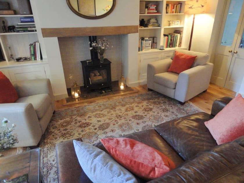 Cosy sitting room with wood burner | Portland Cottage, Helhoughton, near Fakenham