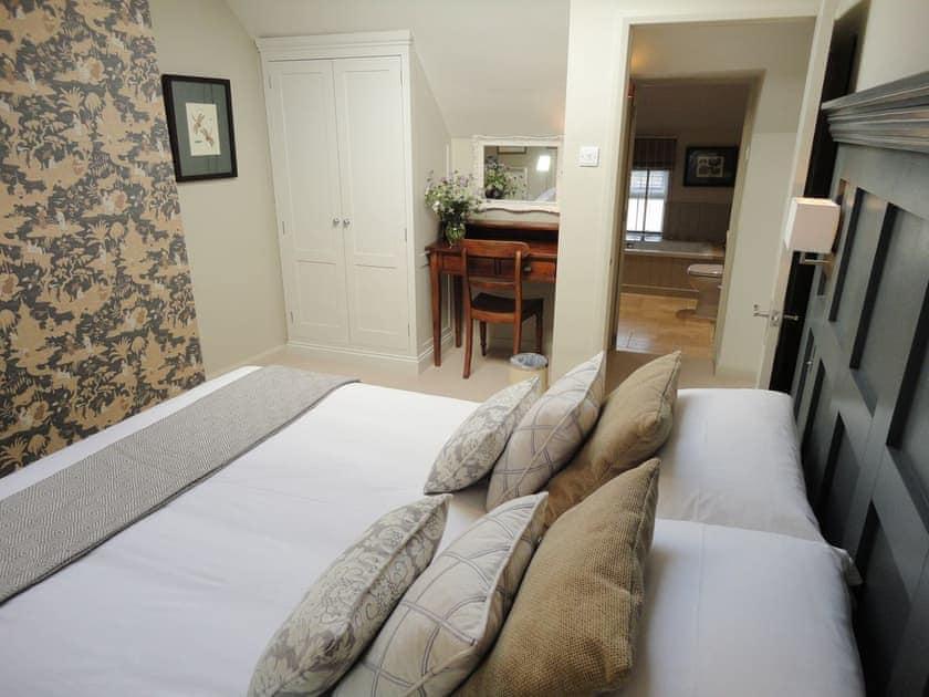 Main bedroom with dressing area | Portland Cottage, Helhoughton, near Fakenham