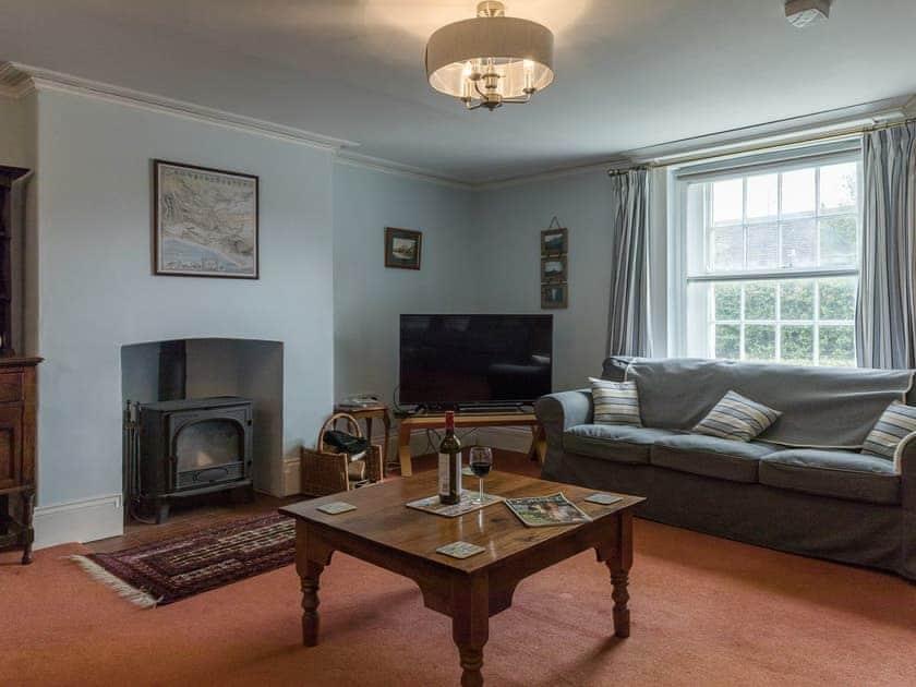 Living room with wood burner    Park Farmhouse, Chideock, near Bridport