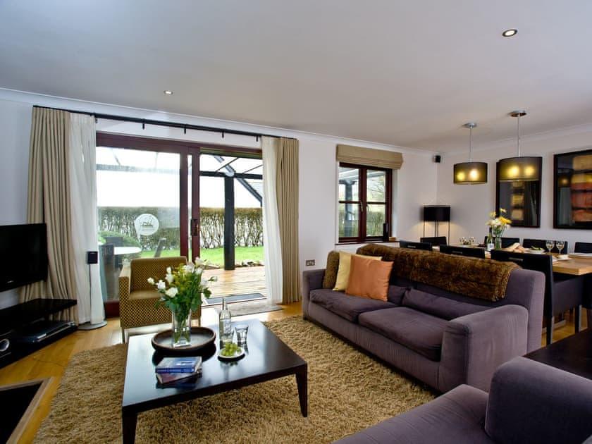 Delightful open living area with doors to the decked area   Lily, Woodland Retreat - Woodland Retreat, Wadebridge