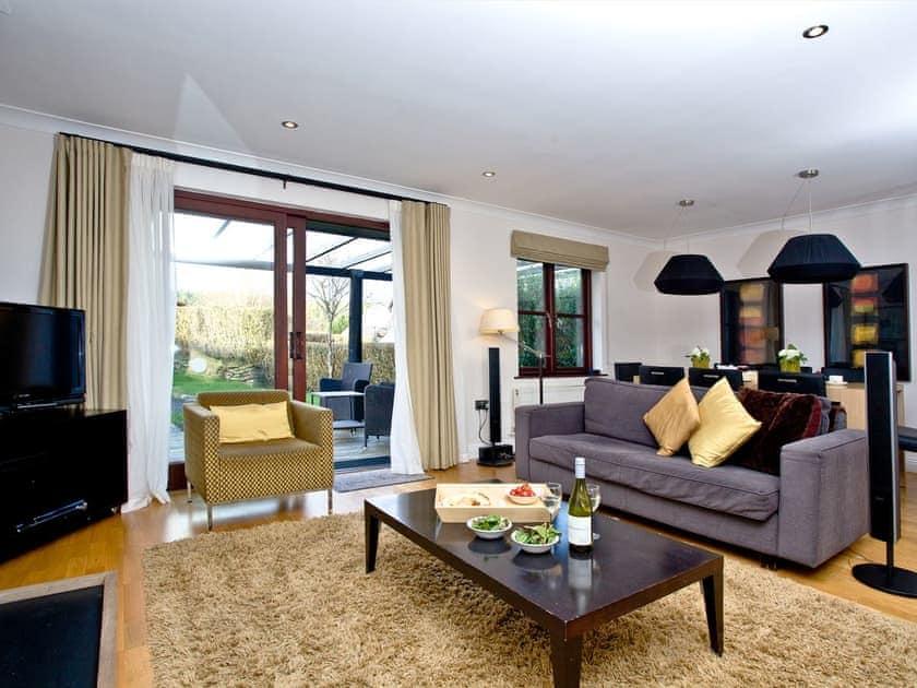 Living room with doors to the garden | Orchid, Woodland Retreat - Woodland Retreat, Wadebridge