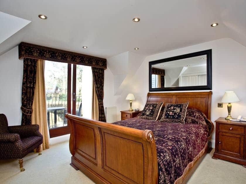 Welcoming double bedroom with sleigh bed | Primrose, Woodland Retreat - Woodland Retreat, Wadebridge