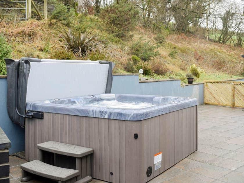 Enclosed rear courtyard with hot tub | Beudy - Bwlch Y Person Barns, Dihewyd, near Aberaeron