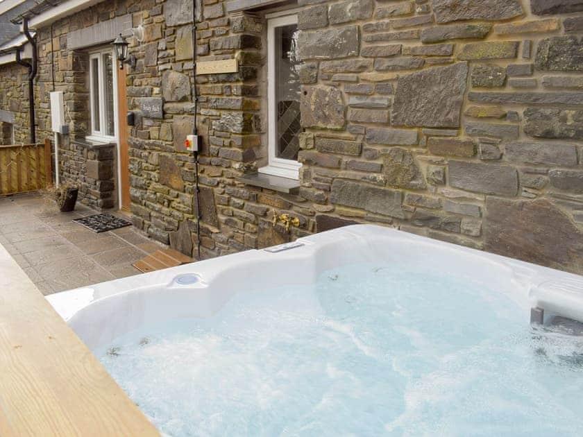 Hot tub on the patio | Beudy Bach - Bwlch Y Person Barns, Dihewyd, near Aberaeron