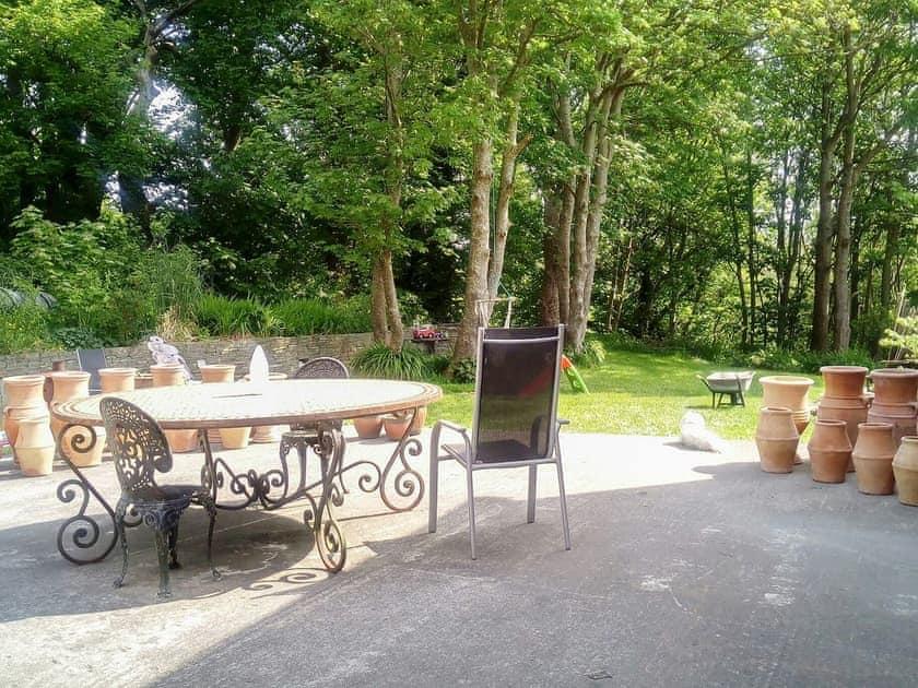 Relax on the paved patio | The Coach House, Ennistymon, near Lahinch