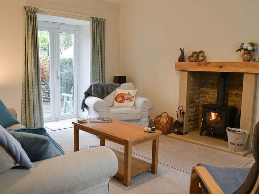 Living room with wood burner | Desmond House, Middleton-In-Teesdale