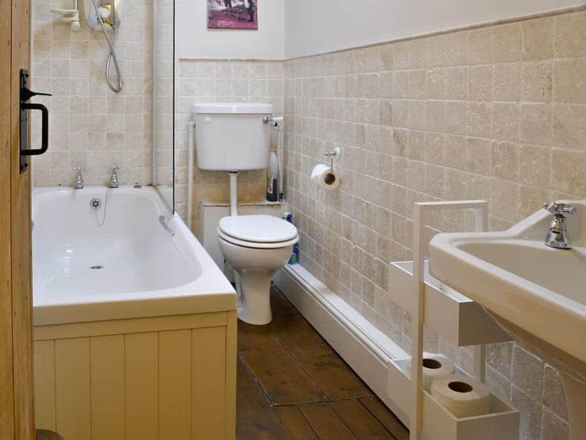 Family bathroom with shower over bath | Whisper Cottage, Hebden near Grassington