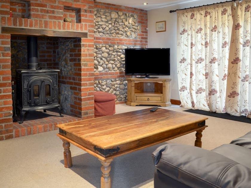 Delightful living room with wood burner | Church Farm Barn - Moor Farm Stable Cottages, Foxley, near Fakenham