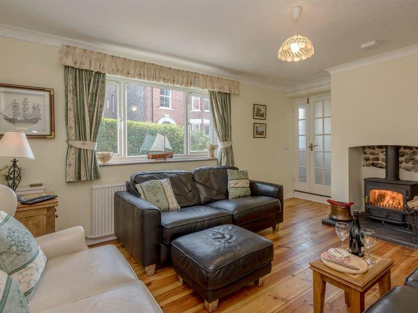 Charming living roomwith wood burner | West End Cottage, Sheringham