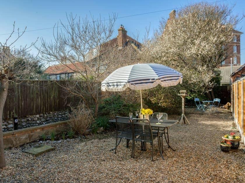 Delightful garden area | West End Cottage, Sheringham