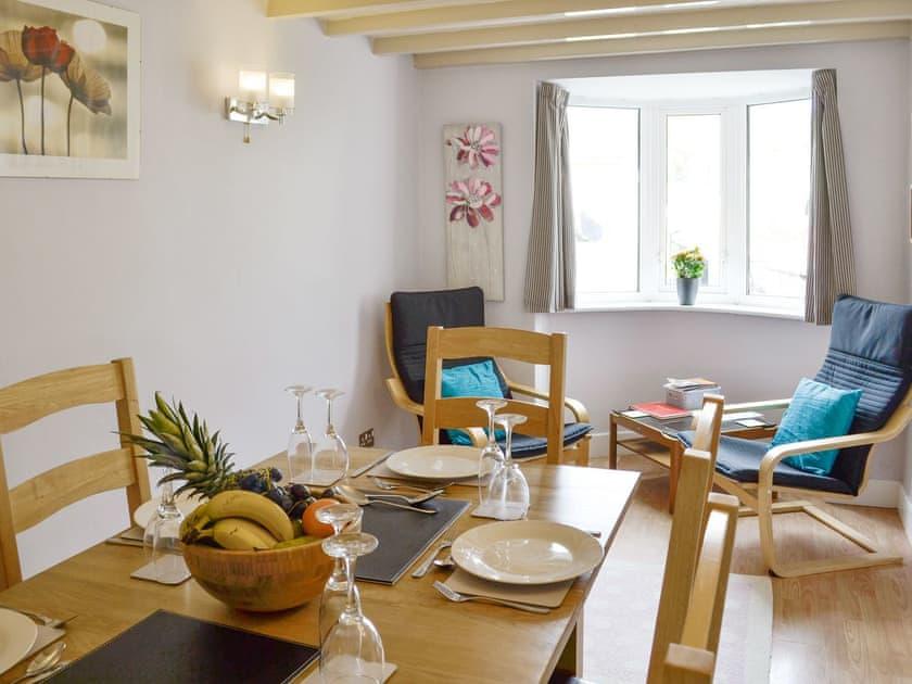 Spacious dining room with seating area | Bryn Bethel, Penrhyndeudraeth, near Porthmadog