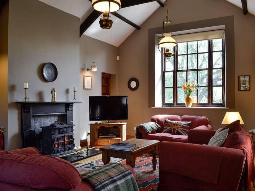 Living room with wood burner | The Old School Penallt , Penallt, near Monmouth