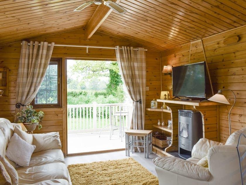 Living area with door to terrace | Llama Lodge, Churchstanton, near Honiton