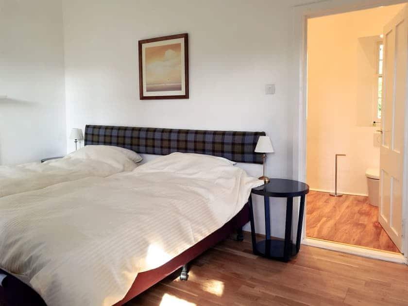 Bedroom with en-suite shower room | Lochside Cottage - Torridon Estate, Torridon