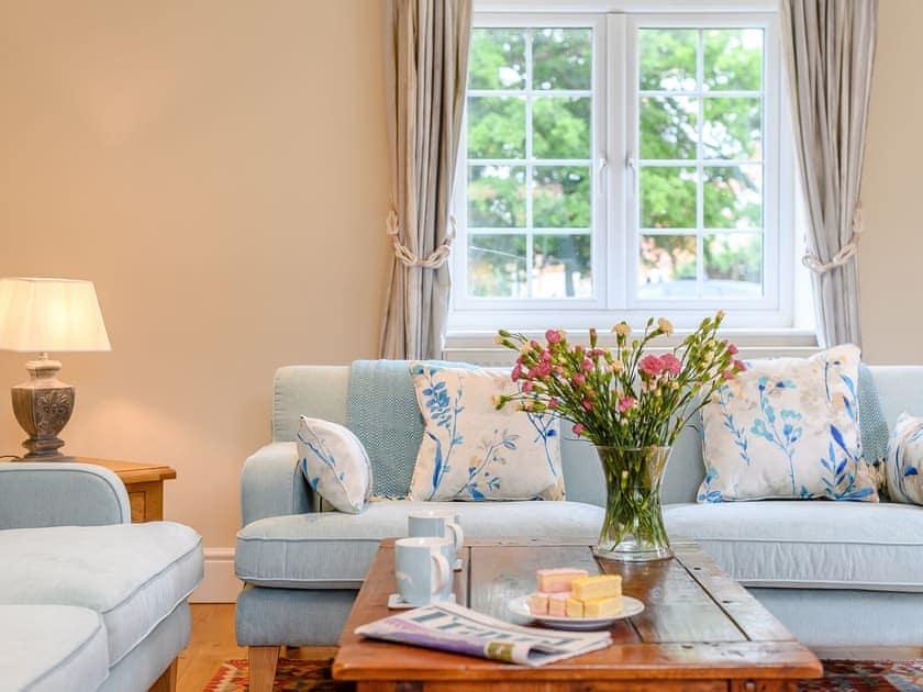 Comfortable bedroom with wood burner   Sea Lavender Cottage - Hall Lane Cottages, Thornham, near Kings Lynn