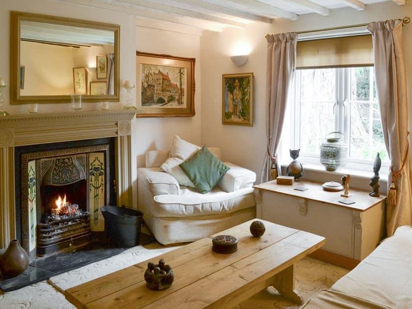 Welcoming snug with open coal fire   Walnut Tree House, Tilney St Lawrence, near King's Lynn