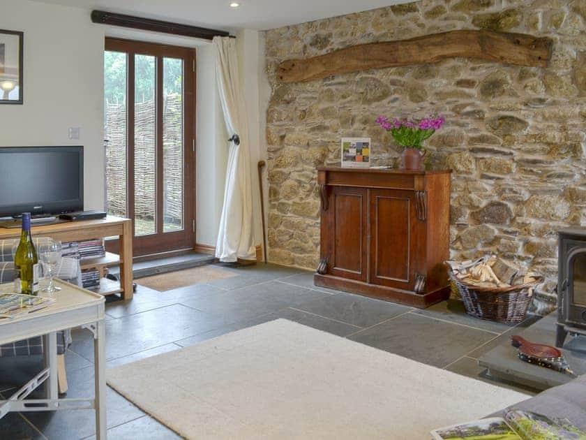 Spacious living room | Primrose - Lower Millcombe Barns, Linkinhorne, near Callington
