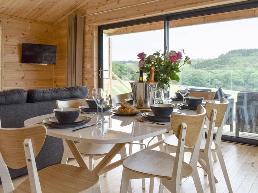 Convenient dining area   Poppy - Buckland Farm Log Cabins, Buckland St Mary, near Taunton