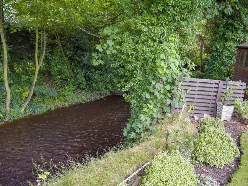 Stream running through garden   Wansbeck Cottage, West Ayton, near Scarborough