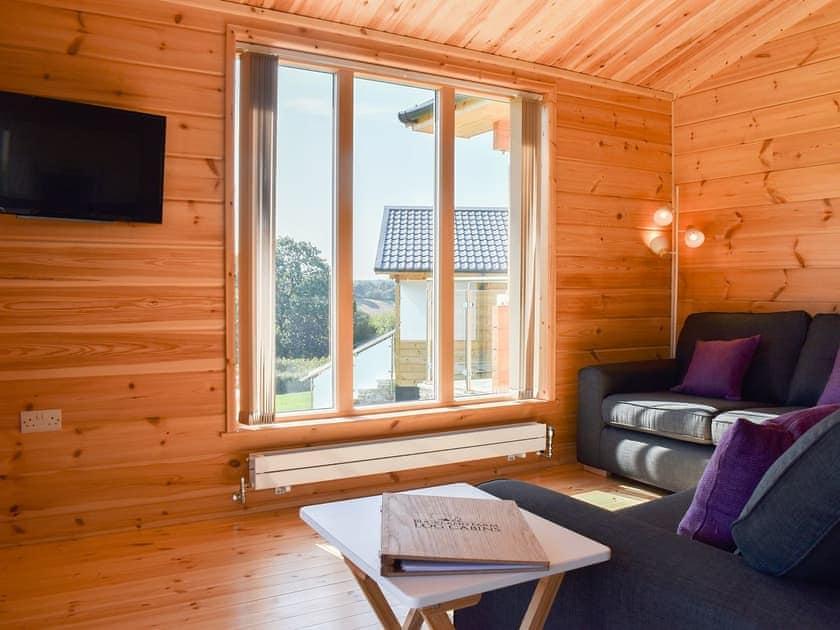Stylish living and dining room | Foxglove - Buckland Farm Log Cabins, Buckland St Mary, near Taunton