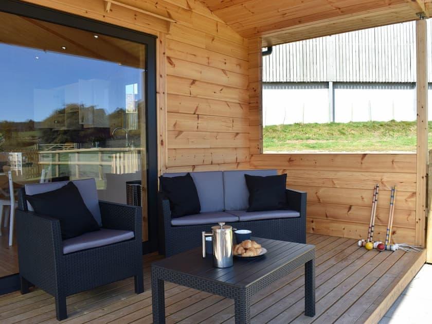 Spacious balcony with outdoor furniture | Foxglove - Buckland Farm Log Cabins, Buckland St Mary, near Taunton