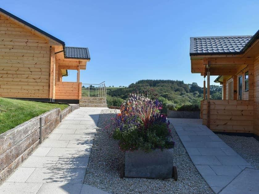 Well-maintained patio areas | Foxglove - Buckland Farm Log Cabins, Buckland St Mary, near Taunton