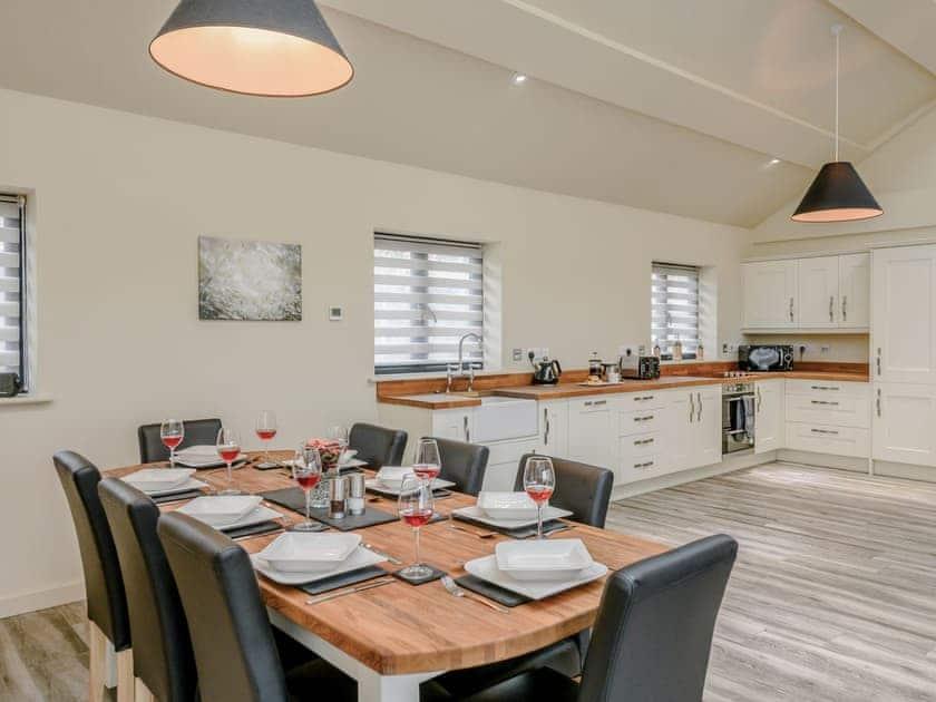 Dining area and adjacent kitchen | Holton Barn - White House Lodges, Heveningham, near Halesworth