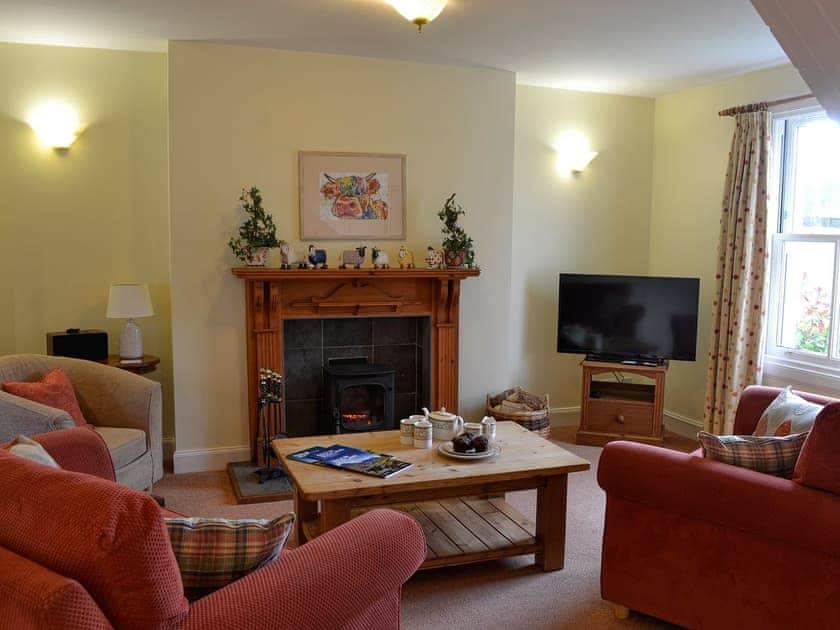 Living room | Heather Lodge - Cally Farm Cottages, Ballintuim, near Blairgowrie