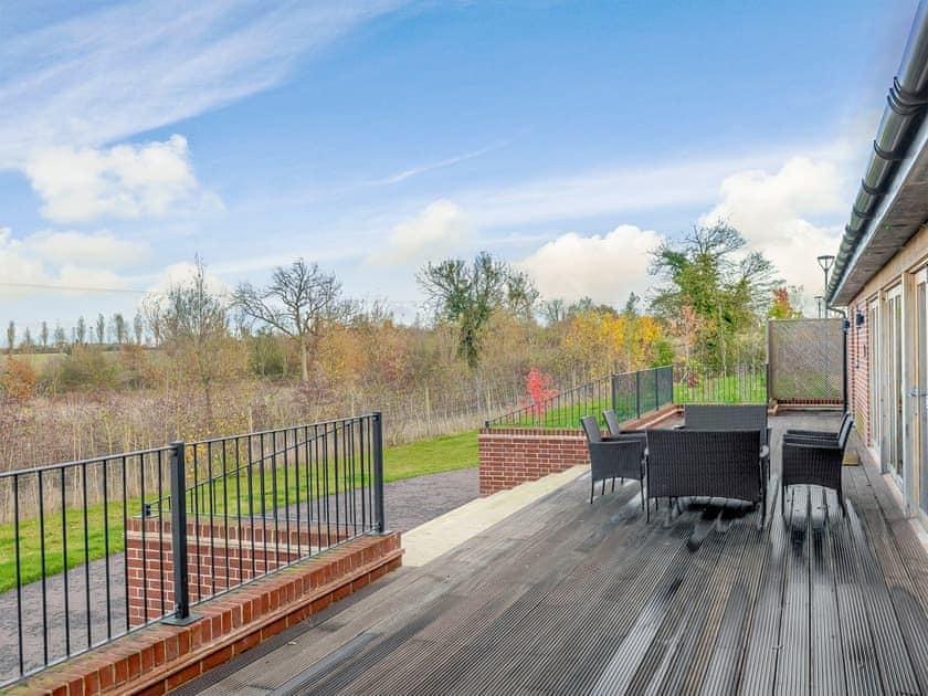 Spacious decking area | Holton Barn - White House Lodges, Heveningham, near Halesworth