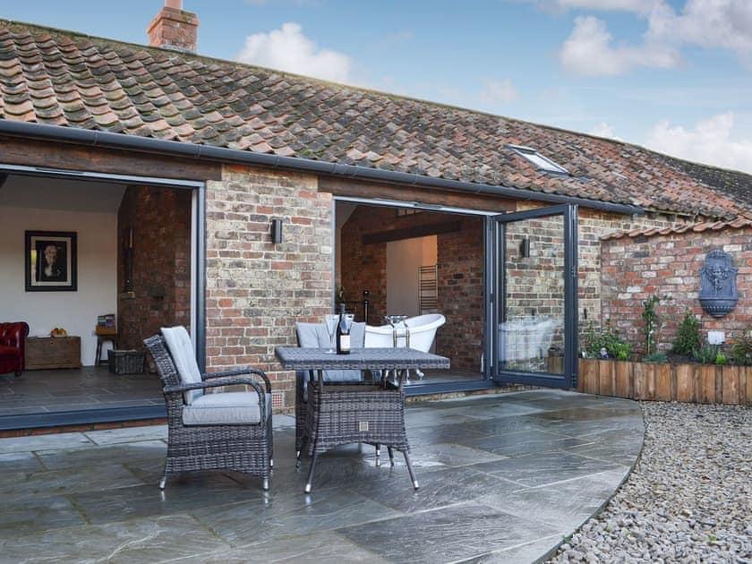 Outdoor area with bi-folding doors | Sunset Barn - Westfield Barns, Normanby, near Helmsley