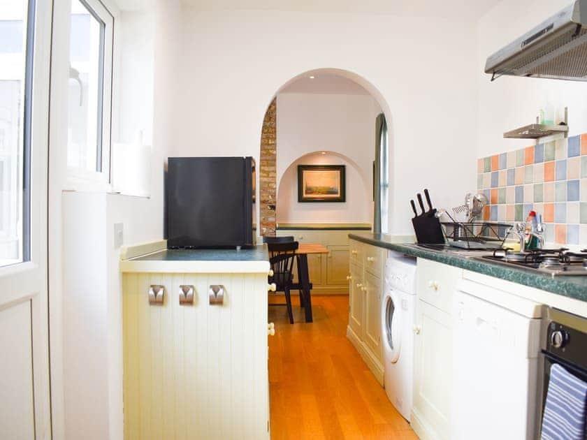 Compact galley style kitchen | Hiham Lodge, Winchelsea, near Rye