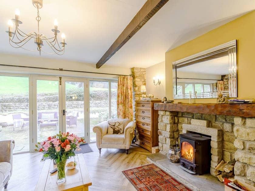 Cosy wood burner in the living area | The Forge - Laskill Grange, Bilsdale, near Helmsley
