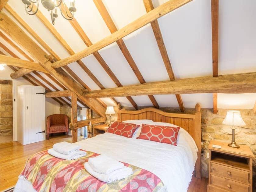 Double bedroom with beamed ceiling   The Granary - Laskill Grange, Bilsdale, near Helmsley