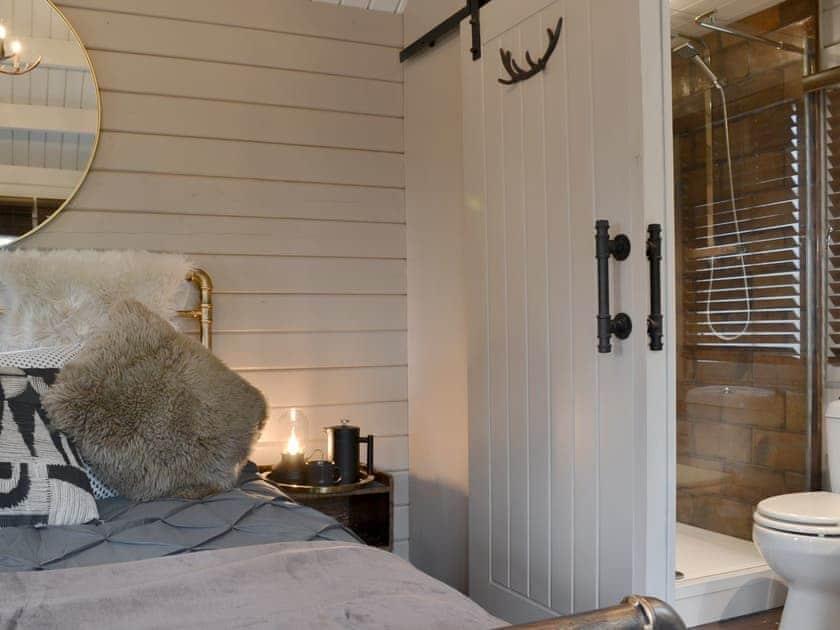 Bedroom area with en-suite | Tarka Cabin - Beaconside, Monkleigh, near Bideford