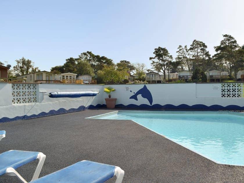On-site swimming pool | Sea View, Tranquillity - Dinas Country Club, Dinas, near Fishguard