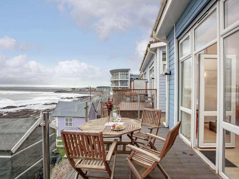 Attractive terrace area   Sea Front House 4 - Golden Bay Holiday Village, Westward Ho!