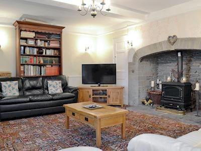 Spacious living room with wood burner | Hindwell Farmhouse, Walton near Presteigne
