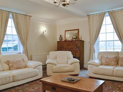 Living room with views to the lake | Hindwell Farmhouse, Walton near Presteigne