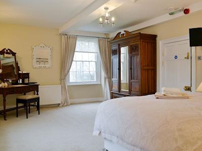 Spacious double bedroom with great views | Hindwell Farmhouse, Walton near Presteigne