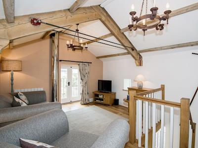 Beamed living room with oak floor | The Hayloft at Mains Farm, Crosby Garrett, near Kirkby Stephen