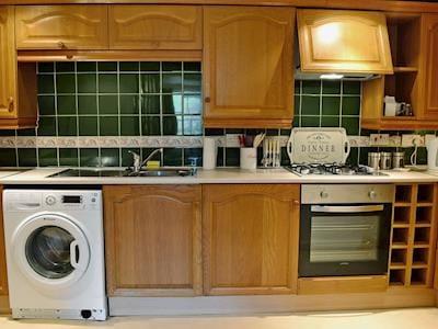 Galley style kitchen | Allan Ramsay Cottage, Carlops near West Linton
